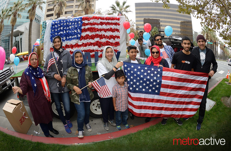 """""""Muslims for Veterans"""" group pose with their float"""