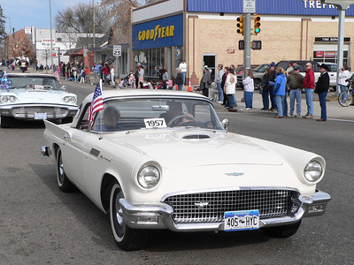 Edna Mae and Elmer Hunter driving their 1957 Thunderbird in the parade