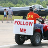 I guess we do what the sign says.  Actually, he was escorting a plane over to the static displays.