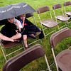 "Andrew Ezell, 5, and his brother, Nathan, 2, wait out the rain storm that moved the ceremony indoors.<br /> The Vietnam Memorial Arch, honoring Boulder County military members who lost their lives in Vietnam, was dedicated in a ceremony at Mountain View Cemetery in Boulder on May 29th, 2010.<br /> For more photos, go to  <a href=""http://www.dailycamera.com"">http://www.dailycamera.com</a>.<br /> Cliff Grassmick / May 29, 2010"
