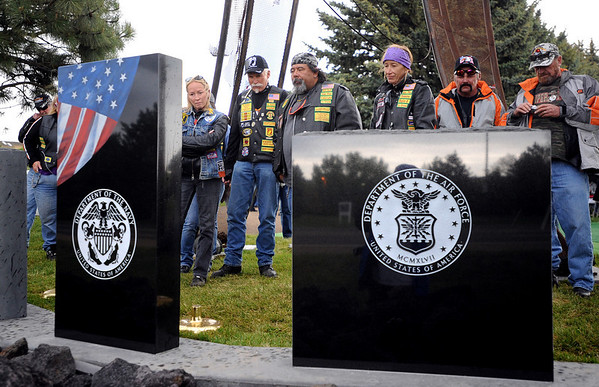 "Guests of the ceremony look at a list of locals who lost their lives in Vietnam.<br /> The Vietnam Memorial Arch, honoring Boulder County military members who lost their lives in Vietnam, was dedicated in a ceremony at Mountain View Cemetery in Boulder on May 29th, 2010.<br /> For more photos, go to  <a href=""http://www.dailycamera.com"">http://www.dailycamera.com</a>.<br /> Cliff Grassmick / May 29, 2010"