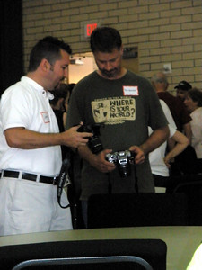 Photographers comparing cameras