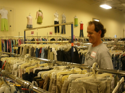 Tom checking tags on clothes