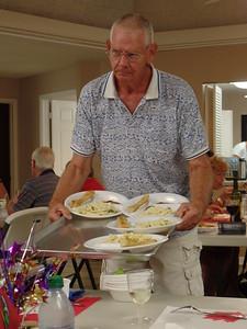 Ken serves the zitta.