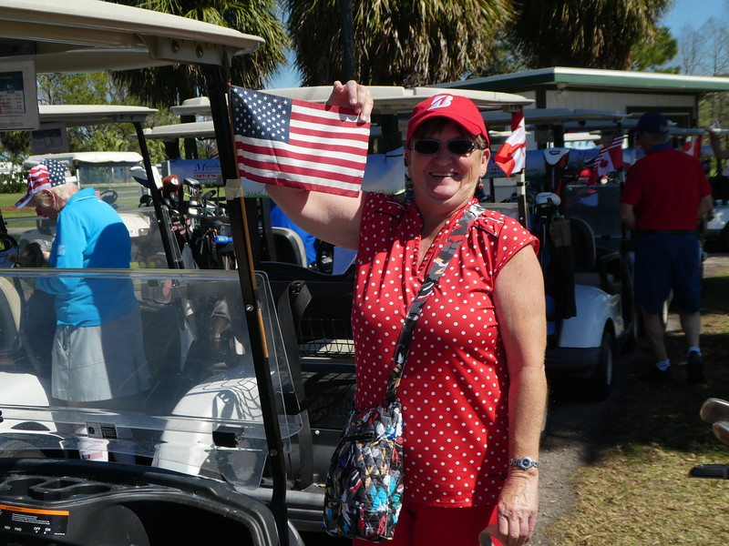 Barb Mannette - Attaching flags to the carts