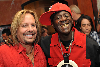 Photograph of Vince Neil and friend Flavor Flav American  rapper, television star, and member of the rap group Public Enemy. Flavor Flav, pictured here, is an American  rapper, television star, and member of the rap group Public Enemy. Public Enemy's hype man, Flavor Flav, has a new memoir titled Flavor Flav: The Icon The Memoir which reveals some of the reality star's most private past experiences. One of the more interesting anecdotes is the fact that he spent $2,600 a day on drugs for 6 years which is about $6 million dollars. Flavor Flav is very lucky to be alive.He did get clean after moving away from New York proving it's never too late to start over. Photograph by Las Vegas photographer Mark Bowers.