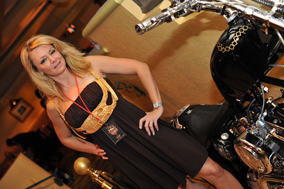 Photograph of Gabrielle Reisler of Gaming today. Rocker Vince Neil opening his Tres Rios cantina and tequila bar in the Las Vegas Hilton Casino Resort.  Tres Rios Tequila is Vince Neil's new single agave tequila made at Tequila Tlaquepaque under the care of the Sanchez Martin Family in Guadalajara, Mexico. This rocker's tequila comes as Tres Rios Silver, Tres Rios Reposado and Tres Rios Anejo. Photograph by Las Vegas photographer Mark Bowers.