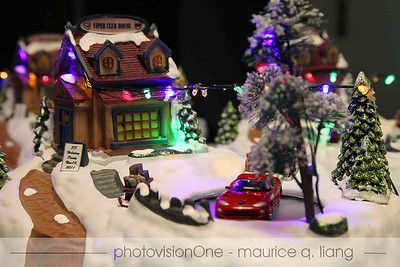 """2011 Viper Club of America, Northern California Region holiday party.  Centerpieces by Maurice, feature a snow village scene with the """"Viper Club House"""", Christmas lights, and a rotating Viper."""