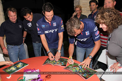 Drivers sign D'Ann's magazine which features her Viper collection.