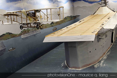 A model of the first aircraft carrier.  The plane would hook the ropes tied to sand bags to stop.