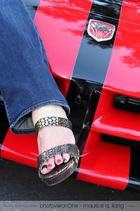 Janis sports matching snakeskin shoes and toenail polish!