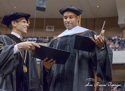 VCU president Michael Rao presents the Honorary Doctor of Humane Letters to former VCU graduate Boris Kodjoe