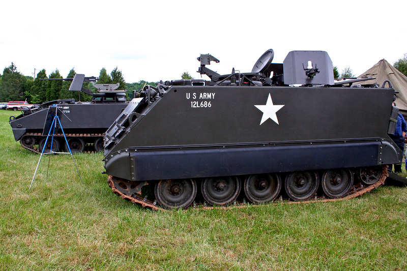 M113 Armored Personnel Carrier (foreground)<br /> M114 APC (background)