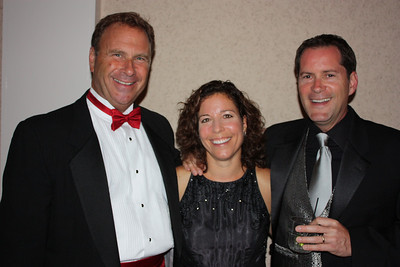 Hosts Bill and Dana Halle with auctioneer Russ Stolnack