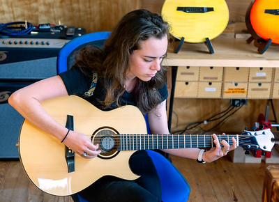 Hannah test drives a new guitar