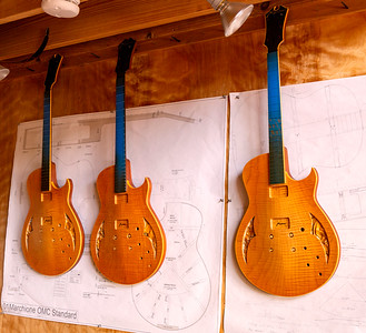 Three electric guitars under construction
