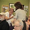 Nancy Barnes Receives Her Award From Serena Rinker