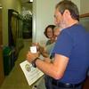 <b>Volunteers Sherry Johnson, Jeff Kramer and Bruce Rosenberg inspect each other's certificates</b> March 26, 2015 <i>- Anthony Lang</i>