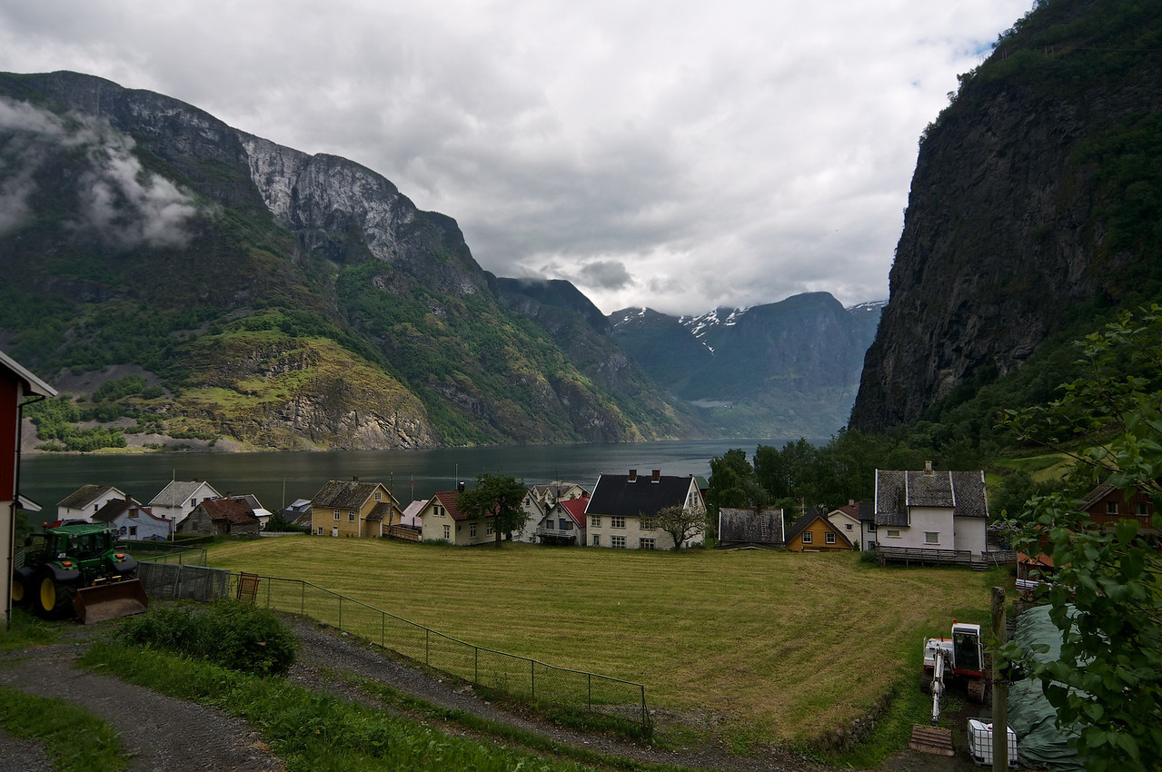 """Undredal. Her bur ca 100 fastbuande og 500 geiter.  Undredal is a small village in the municipality of Aurland in Sogn og Fjordane county, Norway. It is located along the Aurlandsfjord, about 5 kilometres (3.1 mi) south of the Nærøyfjord. The popular tourist destination of Undredal is located along the Aurlandsfjord which is a branch off the massive Sognefjord in Norway's """"fjord-country."""" It is most beautiful and also home to the smallest Stave church in Northern Europe"""