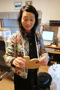 Naomi san wears one of the Peace Dove name plates handmade by Soh Horie.