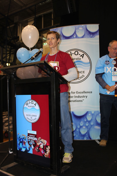 Allan Luyt from Barcaldine Regional Council accepts the Water of Origin Trophy