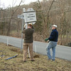 installing a new sign (the old one was damaged in a car accident)