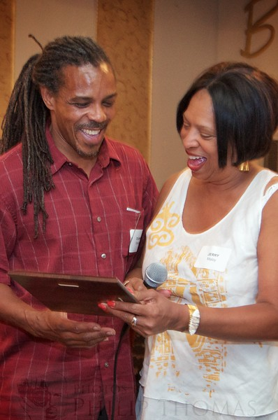 """Duane Savage presented with the """"Person of the Year"""" award by Jerlyn Maloy."""
