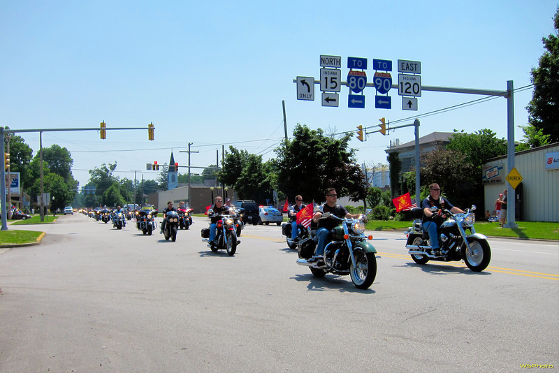 "World Trade Center beam travels through Bristol, IN on it's way to the Osolo Township Fire Department in Elkhart where it will serve as a 9/11 monument centerpiece. Four to five hundred Northern Indiana Patriot Guard were part of the procession along with a small contingent of firefighters and their families and an estimated 1,500 motorcycles.<br /> <br /> I just happened to be in the right place at about the right time but only had my S90 with me, not my DSLR. I shot these with my right hand while shooting video ( <a href=""http://youtu.be/a6Itdqi-Bd8"">http://youtu.be/a6Itdqi-Bd8</a>) with my DroidX held with my left hand. It was quite the juggling act."