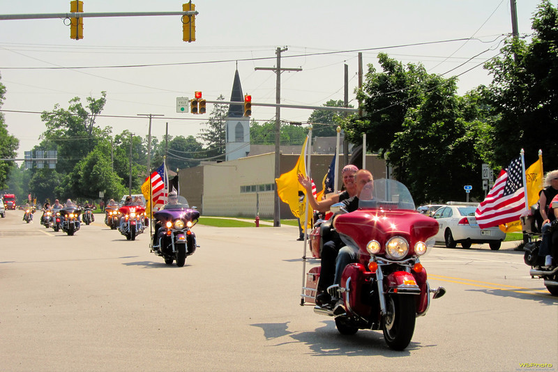 """World Trade Center beam travels through Bristol, IN on it's way to the Osolo Township Fire Department in Elkhart where it will serve as a 9/11 monument centerpiece. Four to five hundred Northern Indiana Patriot Guard were part of the procession along with a small contingent of firefighters and their families and an estimated 1,500 motorcycles.<br /> <br /> I just happened to be in the right place at about the right time but only had my S90 with me, not my DSLR. I shot these with my right hand while shooting video ( <a href=""""http://youtu.be/a6Itdqi-Bd8"""">http://youtu.be/a6Itdqi-Bd8</a>) with my DroidX held with my left hand. It was quite the juggling act."""