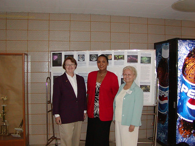 Jacquie Roberts (center) poses with two University of Guam faculty members.