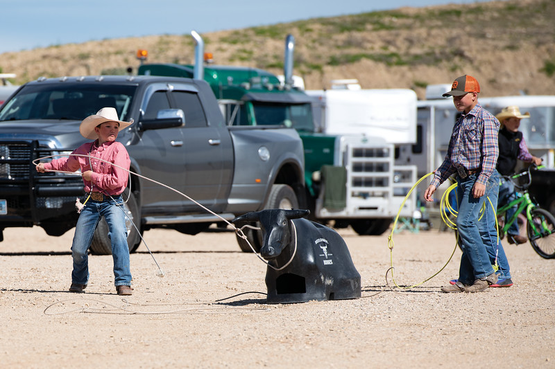 Matthew Gaston | The Sheridan Press<br>Jace Rourke, 12, left, and Carter Hutchinson, 11, perfect their roping skills in the parking lot at the Sheridan College Agripark Saturday, June 22, 2019.
