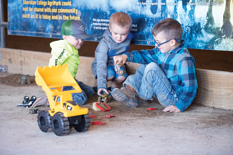 Matthew Gaston | The Sheridan Press<br>Three boys play with trucks in the dirt beside the arena at the Sheridan College Agripark during the WYJRA Rodeo Saturday, June 22, 2019.