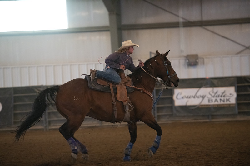 Matthew Gaston | The Sheridan Press<br>Rylie Persson prepares to dismount during the senior girls goat tying event at the Wyoming Junior Rodeo Association Rodeo Saturday, June 22, 2019.