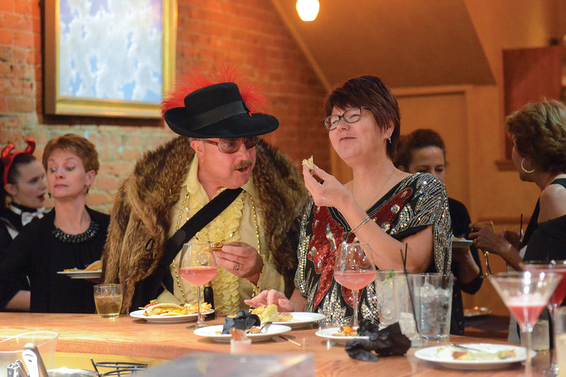 "Ashleigh Fox | The Sheridan Press<br /> <br /> Billy Craft, dressed as ""Bebbit Jones,"" enjoys hors d'oeuvre with his wife and director of the WYO Theater production of ""Sister Act,"" Marva Craft."