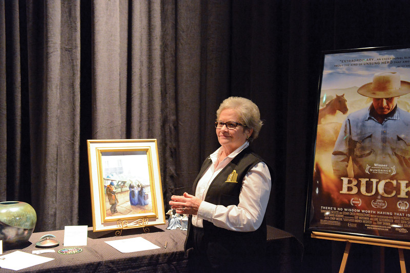 Ashleigh Fox | The Sheridan Press<br /> <br /> WYO Theater volunteer Cathy Storm monitors the silent auction items during intermission of the WYO Theater 2017 Gala on Saturday night.