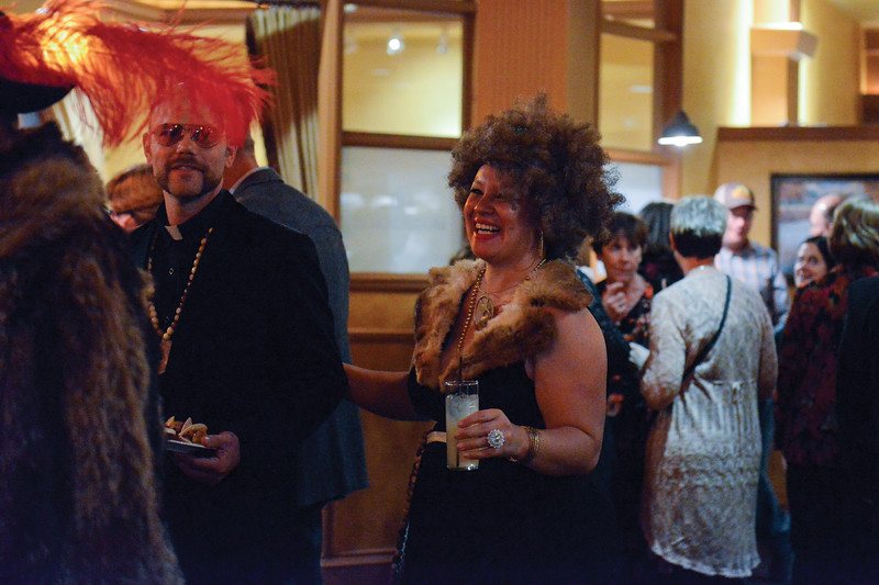 "Ashleigh Fox | The Sheridan Press<br /> <br /> Elizabeth Craft, dressed as ""Sister Foxy Clarence,"" giggles at Billy Craft while walking with JT Craft, dressed as ""Fatha Frankie the Fist."" The couple dressed to the ""Sister Act"" theme for the WYO Theater 2017 Gala."