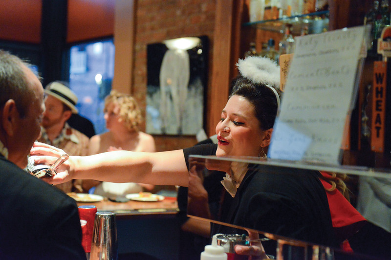 "Ashleigh Fox | The Sheridan Press<br /> <br /> Sydney Bower pours a drink during the cocktail hour at Frackelton's ahead of the performance of ""Sister Act"" for the WYO Theater 2017 Gala."