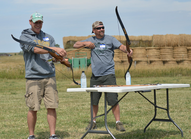 Ryan Patterson | The Sheridan Press<br /> Jared Severson, left, and Travis Reed laugh during the WYO West Warriors Foundation weekend at the Dow Ranch Friday, Aug. 31, 2018. The five-day event brought more than 30 veterans and their friends and family to the Sheridan area for camaraderie and relaxation.