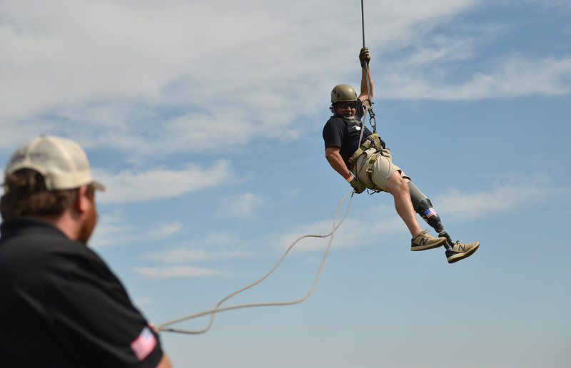 Ryan Patterson | The Sheridan Press<br /> Gabriel Monreal of San Antonio rappels during the WYO West Warriors Foundation weekend at the Dow Ranch Friday, Aug. 31, 2018. The five-day event brought more than 30 veterans and their friends and family to the Sheridan area for camaraderie and relaxation.