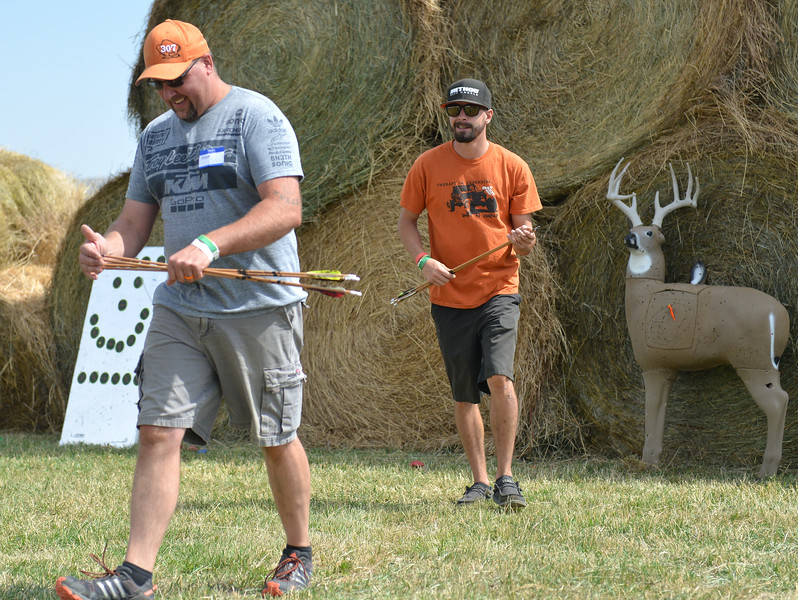 Ryan Patterson | The Sheridan Press<br /> Josh Williams, left, and Kody Williams retrieve arrows from a shooting range during the WYO West Warriors Foundation weekend at the Dow Ranch Friday, Aug. 31, 2018. The five-day event brought more than 30 veterans and their friends and family to the Sheridan area for camaraderie and relaxation.