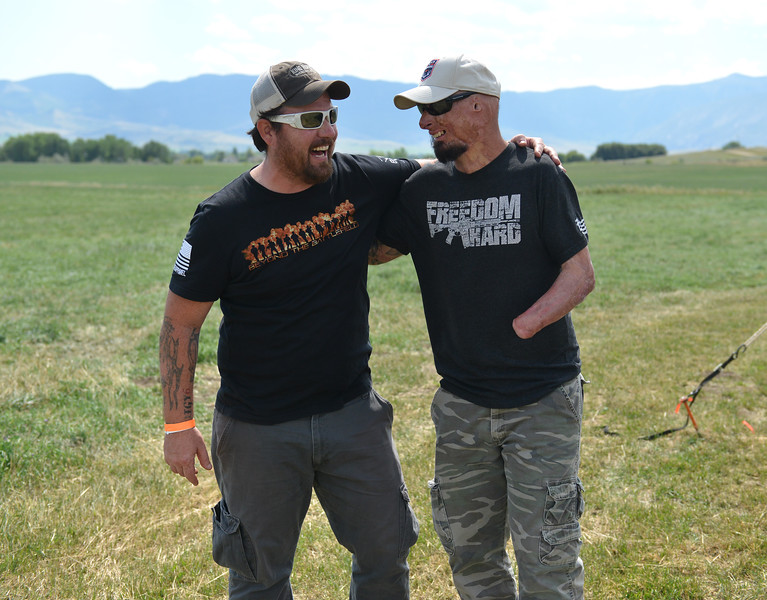 Ryan Patterson | The Sheridan Press<br /> Jonathan Hanock, left, and Bobby Henline laugh during the WYO West Warriors Foundation weekend at the Dow Ranch Friday, Aug. 31, 2018. The five-day event brought more than 30 veterans and their friends and family to the Sheridan area for camaraderie and relaxation.