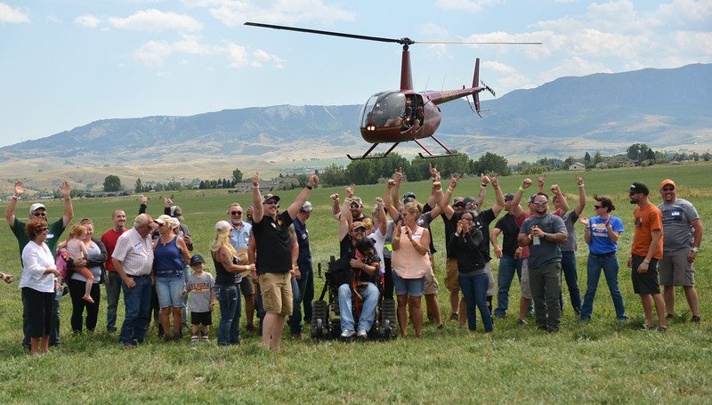 Ryan Patterson | The Sheridan Press<br /> Veterans, friends and family cheer during the WYO West Warriors Foundation weekend at the Dow Ranch Friday, Aug. 31, 2018. The five-day event brought more than 30 veterans and their friends and family to the Sheridan area for camaraderie and relaxation.