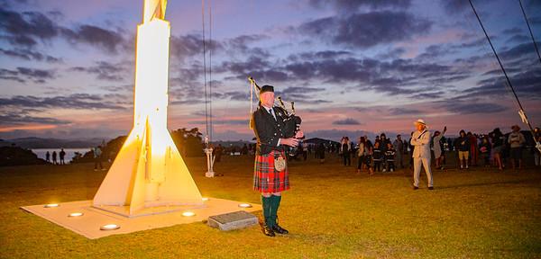 Flag raising ceremony with bagpiper Bain McGregor, Waitangi 2021