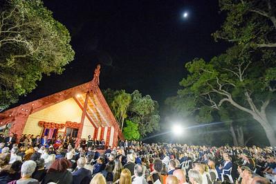 The moon shines down on during the dawn ceremony at Te Whare Rūnanga