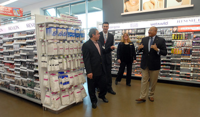Berwyn Mayor and Berwyn Township Supervisor, Elizabeth Pechous get a tour of the additions to the Walgreens alongside employees (left-right) Store Manager Jamie Chambers and Director of Government Relations, Donovan Pepper after a ribbon cutting ceremony for the grand re-opening Wednesday Dec. 5, 2012. The new additions include Fresh Foods, Home Health Care Center and Expanded Beauty Center. Staff photo by Erica Benson