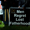 Men regret lost fatherhood (taken under the stage). A new sign I'd never seen before.