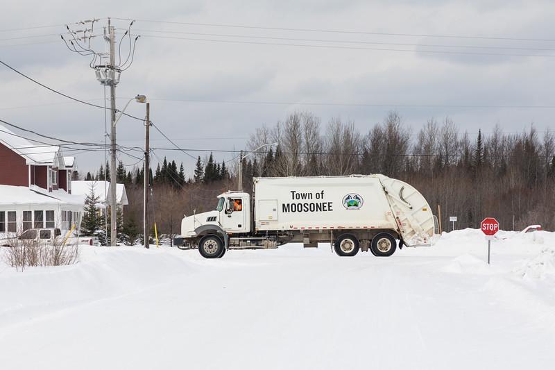 Town of Moosonee garbage truck on Atim Road crossing Gardiner Road.