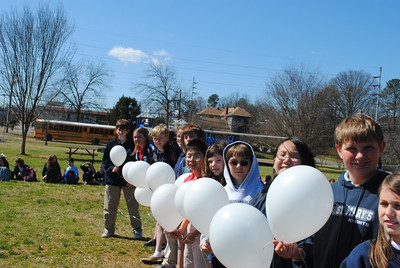 On the second day of the papal conclave students at St. Mary's School, Rome, hold white balloons to symbolize the white smoke released at the Vatican when Argentine Cardinal Jorge Mario Bergoglio was named the 266th pope of the Roman Catholic Church. (Photo Courtesy of St. Mary's School)