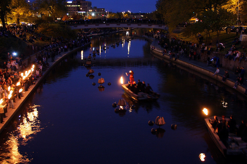 Boats with lit torches, getting ready to light the fires.