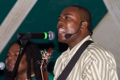"""Adrian """"the Docl"""" Martinez with Andy Palacio and the Garifuna Collective performing live at Y-Not Island in Dangriga, Stann Creek, Belize."""